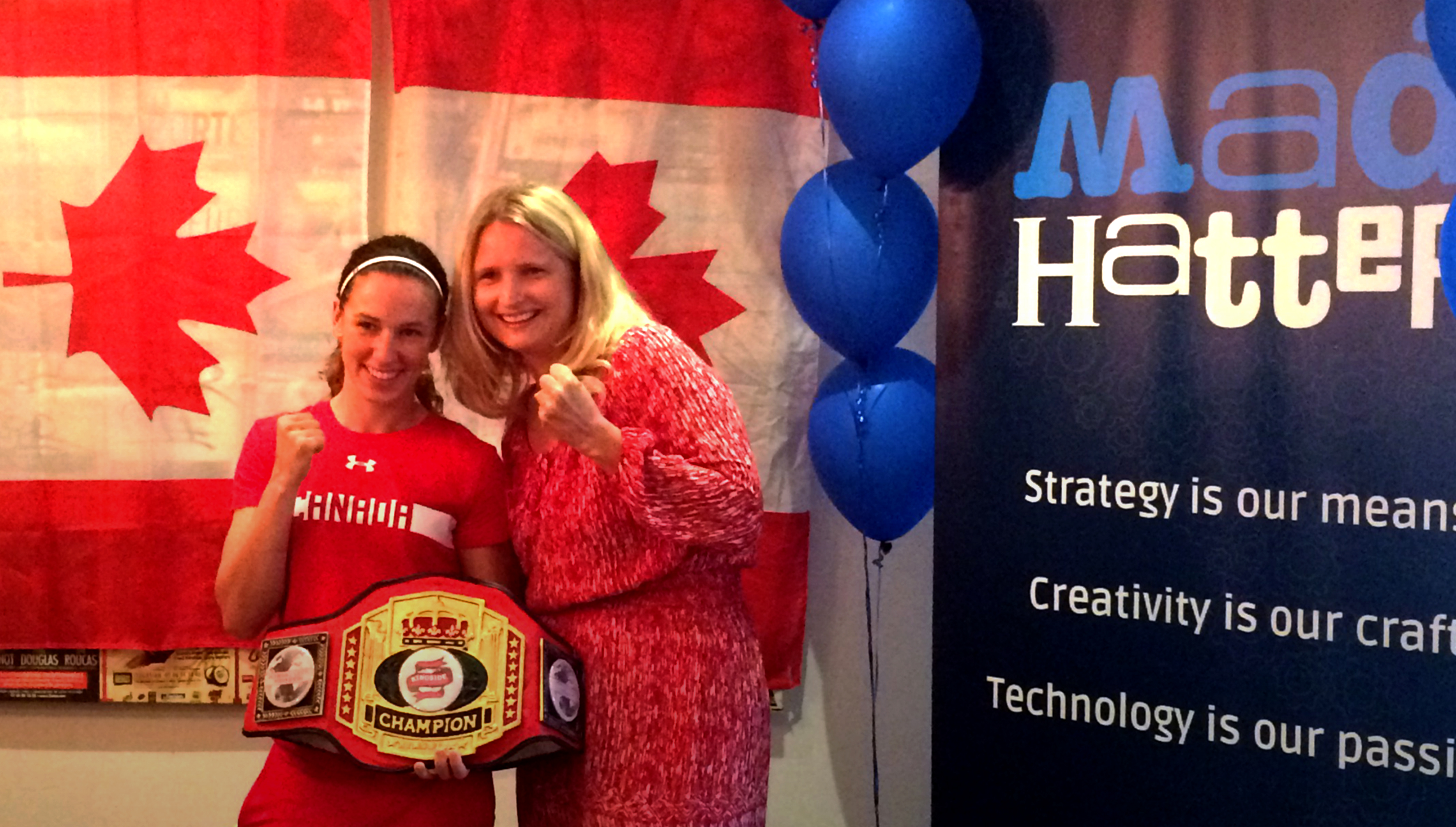 Boxer Mandy Bujold and Melanie Witzell, Agency Director, Mad Hatter Technology at a send off for Mandy at the Mad Hatter Technology office.