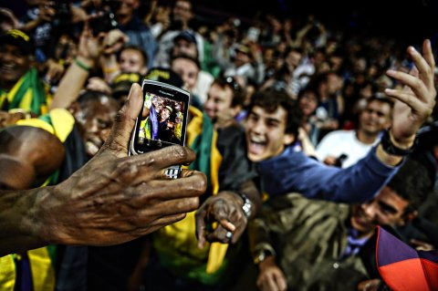 Usain Bolt takes selfie with fans at the Rio Olympic Games